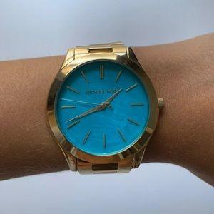 Brand new Women's Michael Kors gold watch
